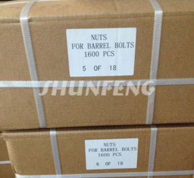 Several boxed containing hex nuts are bounded with pieces of white plastic belts for easy transportation.
